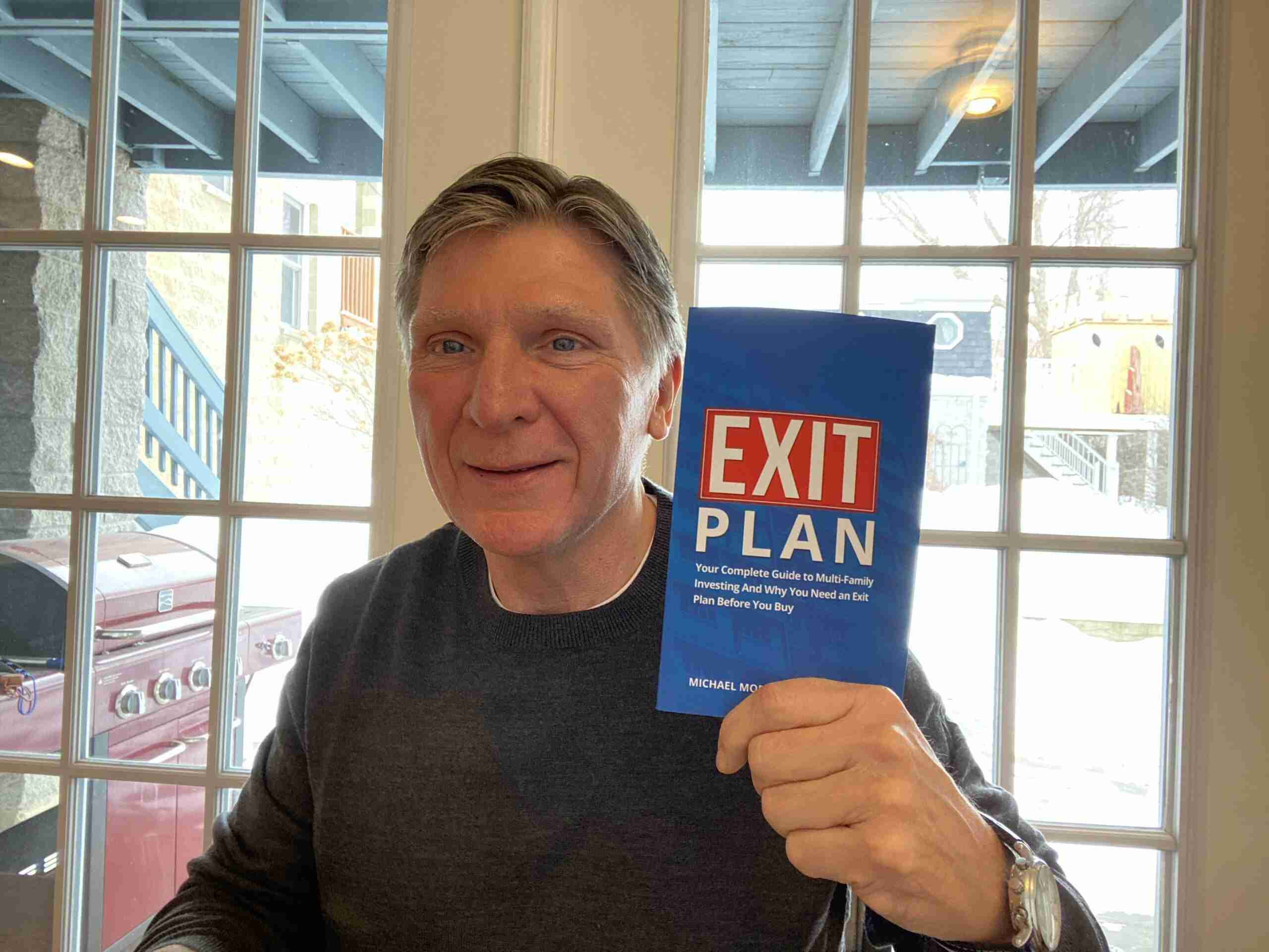Mike holding Exit Plan book